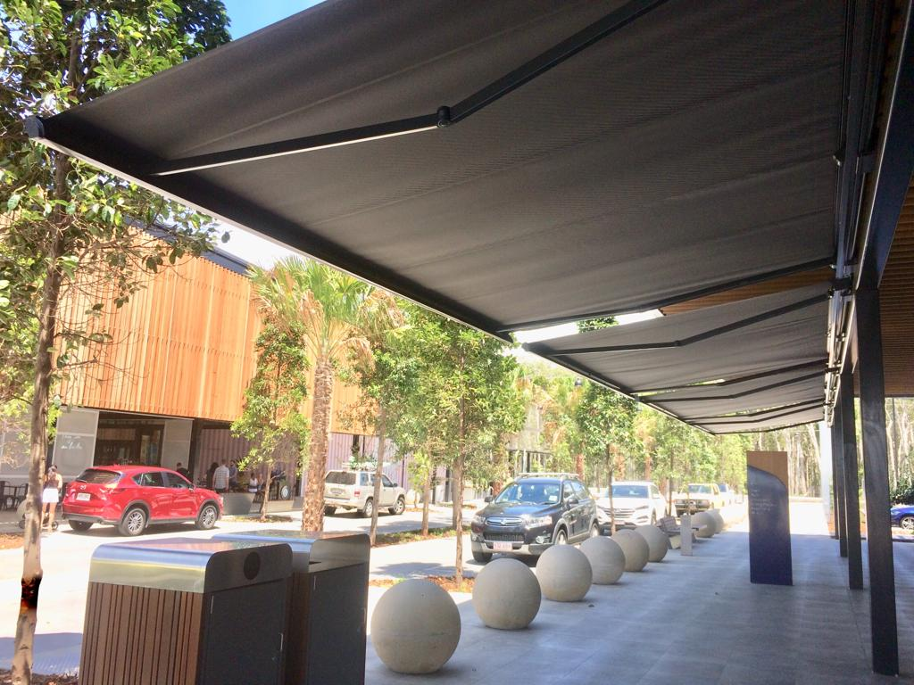 Folding Arm Awning Brisbane commercial awnings and blinds